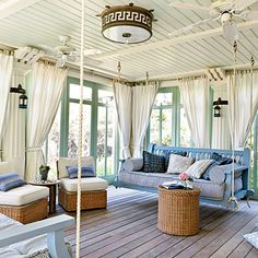 The cozy porch is perfect for taking a seaside snooze. Nautical rope details on the swing lend a beach vibe, and curtains and screens ensure hours of uninterrupted comfort.