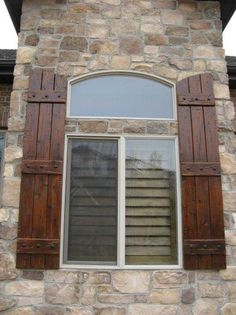 Rustic Shutters... Yes! This is very similar to what I want for our shutters, but with iron hinge accents