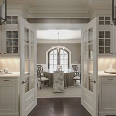 Benjamin Moore Color...Ashley Gray.  Love this layout of dining room doors centered in kitchen.