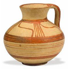 A MYCENAEAN POTTERY JUG CIRCA 14TH-12TH CENTURY B.C.
