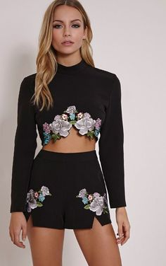 Black Floral Embroidered Shorts Work florals with an edge in these boldly embroidered flower det...