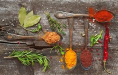 Spices - Spices and herbs on old wooden board