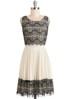 Rockin' Romance Dress. If spontaneity is the secret to your crushs heart, youre soon to capture it while wearing the black lace overlay of this ivory dress by Darling! #prom #modcloth