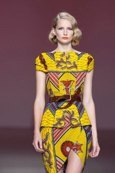 African Dress style. Lower the hem and loose the slit and i'll take it!!