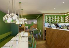London studio Gundry & Ducker have added oak booths and stencilled tree-like graphics to the interior of an Italian chain restaurant in Hertfordshire, England. Greens Restaurant, Cool Restaurant, Restaurant Lighting, Restaurant Concept, Restaurant Interior Design, Cafe Interior, Restaurant Interiors, Cafe Bar, Commercial Design
