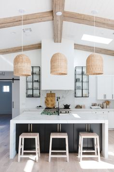 Contemporary kitchen basket pendant lighting waterfall countertops wood beam ceilings white cabinetry modern kitchen marble backsplash open glass cabinetry barn door the lifestyled company Home Decor Kitchen, Kitchen Interior, New Kitchen, Home Kitchens, Kitchen Ideas, Island Kitchen, Kitchen Cabinets, Kitchen Lamps, Cottage Kitchens