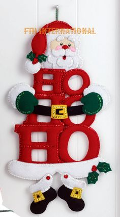Bucilla ~ HO HO Ho Santa ~ Felt Christmas Wall Hanging Kit Bucilla felt applique kits are a Christmas tradition. The designer of this kit found a very clever way to use HO HO HO as the body of the Santa Wall Hanging kit. Christmas Sewing, Felt Christmas, All Things Christmas, Christmas Stockings, Felt Crafts, Christmas Crafts, Christmas Ornaments, Felt Decorations, Christmas Decorations