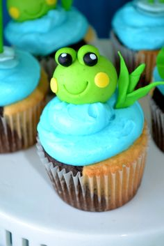 Adorable fondant topped cupcakes at a Frog Party.  See more party ideas at CatchMyParty.com. #frogpartyideas