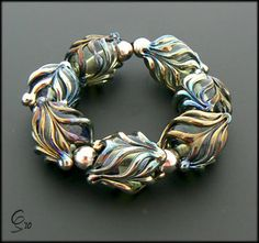 Fantasy - Trans Aqua - Lampwork Glass bead Set by Clare Scott by Photography by Clare Scott, via Flickr
