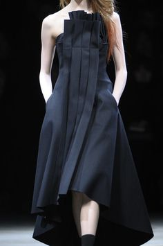 Architecture inspired fashion with structured pleat detail; sculptural fashion design // Yohji Yamamoto