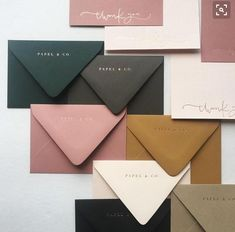 Like the pinkish Mauve, emerald, and gold envelopes