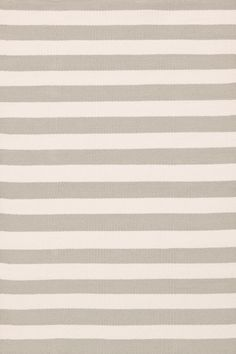 Dash & Albert | Trimaran Stripe Platinum/Ivory Indoor/Outdoor Rug | A rug for all seasons. Made of superheroic polypropylene, our indoor/outdoor area rugs are terrific for high-traffic areas and muddy messes. Scrubbable, bleachable and UV-treated for outdoor use, this collection of woven rugs can stand up to all that you dish out.