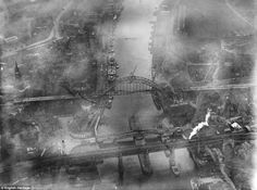 Fog on the Tyne: The Tyne Bridge under construction in Newcastle in 1928 as coal ships and other vessels dock at the riverside