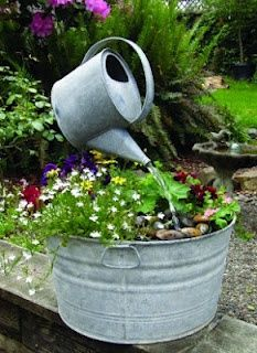 DIY garden fountain : DIY Galvanized Watering Can Garden Art Fountains Homemade Water Fountains, Diy Garden Fountains, Fountain Garden, Diy Water Fountain, Outdoor Fountains, Garden Ponds, Landscape Fountains, Fountain Cake, Fountain House