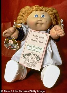 Cabbage Patch Dolls. My lil sis and I each had one. Mine was very similar to this one. Except she had on a different pasted striped rainbow colors dress.