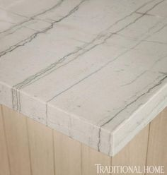 White Macabus quartzite from AKDO  - stone is stain resistant like granite but looks like marble