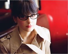 Seriously, how does she pull off glasses AND heavy bangs?