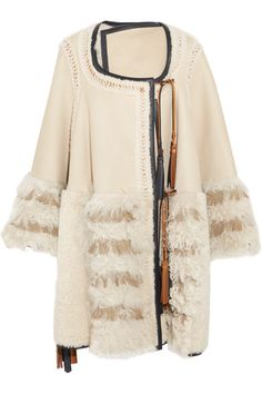 Cream shearling, brown and black leather Slips on 100% shearling (Lamb); trim: 100% leather (Lamb) Specialist clean Designer color: Milk Made in Italy