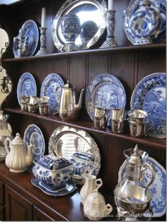 Very traditional, timeless and classic: blue & white porcelain, white china and sterling silver on a Welsh cupboard.