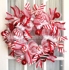 Slim Peppermint Candy themed wreath by www.southerncharmwreaths.com