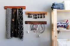 Bungee Cords: Good in the Home, Too  An old board and a bungee cord make for a cheap, lightweight rack to store not-too-heavy things like sunglasses, scarves and wires. Just thread the bungee cord through holes drilled into the boards and fasten with staples. If you want to get fancy, you can also decorate the board.