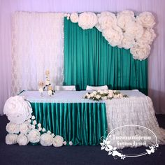 paper flower wall backdrop with table idea