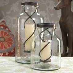 "Twisted Metal in Oversized Glass Jar Candle Holder - Holds any 3"" diameter pillar candle - Small Dimensions: 9.5"" x 15.25"" - Large Dimensions: 9.5"" x 20.75"""