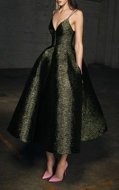 The designer: Amazing party dresses are what the Australian designer is known for (twice featured on the cover of Vogue Australia in 2016).    This season it's about: Shapely, feminine silhouettes show off luxe velvet and textured sparkle—from sophisticated midnight black to bottle green and a fabulous pink.