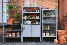 HINDÖ grey outdoor shelving and storage including greenhouse/cabinet.