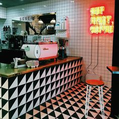 Favorite coffee shop corner! No, not because of the neon sign (which I happened to cut off because I am good at pictures ), but because the tile is what love is made of.  The stool isn't half bad either... Okay I'll take it all. | @oneturnkill