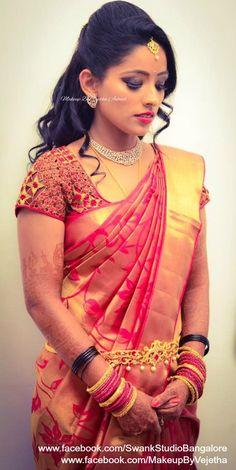 Akhila looks elegant and gorgeous for her reception ceremony. Makeup and hairstyle by Vejetha for Swank Studio. Photo credit: Manish Ananda. Pink lips. Glitter smokey eye makeup. Bridal jewelry. Bridal hair. Curls. Silk sari. Bridal Saree Blouse Design. Indian Bridal Makeup. Indian Bride. Diamond Jewellery. Statement Blouse. Tamil bride. Telugu bride. Kannada bride. Hindu bride. Malayalee bride. Find us at https://www.facebook.com/SwankStudioBangalore