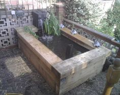 Chris Foster's raised pond with new pine railway sleepers
