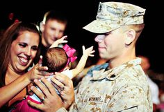 This young Marine holding his six-day-old daughter for the first time: