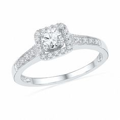 Express your love with this classic and traditional diamond bridal set. Fashioned in 10K white gold, the engagement ring features a 0.20 ct. round diamond centre stone. A squared frame of smaller round accent diamonds surrounds this centre stone, while the ring's shank glistens with additional accent diamonds. On your wedding day, the coordinating diamond-lined wedding band completes the ensemble. Radiant with 0.48 ct. t.w. of diamonds, this bridal set is finished with a polished shine.