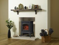 Stove colour choices: Matt Black, Matt Ivory (Small Clarendon electric stove only), Laurel Green & Midnight Blue. Small: 431 x 589 x (w x h x d)* - would fit really well in the space and could look nice with the hearth in the pic but narrower Wood Burner Fireplace, Small Fireplace, Bedroom Fireplace, Living Room With Fireplace, Fireplace Surrounds, Living Room Decor, Dining Room, Home Spa Decor, Electric Stove Fireplace