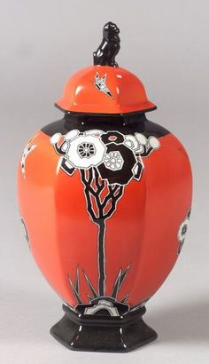 Carlton Ware  Art Deco porcelain covered urn  England, c. 1935  Hexagonal form with stylized red and white flowers on red ground, manufacturer's mark on base, imperfections, ht. 12 in.