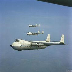 Three Hawker Siddeley Argosys, either of No 114 Squadron or No 267 Squadron both based at RAF Benson, in flight