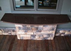 Outdoor Bar, half moon shape, solid brown, square front edge, inlaid clients agate collection throughout...done by artisan James McGregor with McGregor Designs