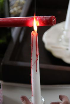 Bloody candles for Halloween...i'd probably do red candles with dripping black, green with black, orange with black, orange with green, and of course the white with red.