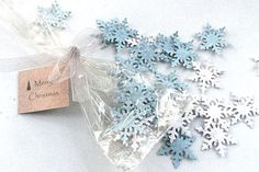 This eco-friendly favor is so cute — guests just sprinkle the seed-embedded snowflakes outside, and flowers will grow!
