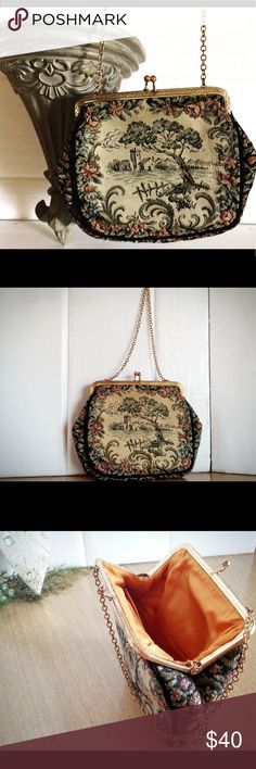 """La Marquise French Tapestry Bag Measurements: Height: 5 ¼ inches Length: 6 ½ inches Chain drop: 5 inches Hinge Opens: 4 ¾ inches Inside Pocket measures: 3 ½ X 2 inches The metal/brass top frame measures 4 ¾ inches in length (Side-to-side). Clean in & out. Pocket stamped; """"La`Marquise"""". Inside has One fleabite/pen size snag on the front of the pocket. Brass/metal top frame, with kiss locking clasp. Chain is attached on either side of the frame. Fame/chain show tarnish in areas, but still…"""