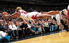 Chicago Bulls power forward Dennis Rodman goes horizontal for a loose ball during a game against the Pacers at the United Center in Chicago, Ill. Rodman won his sixth rebounding title during the 1996-97 season averaging 16.1 total rebounds a game.