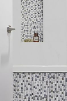 The bathroom—and also the kids' bedroom—are situated on the ground floor in the front of the house. Home Depot standard white glazed square tiles are offset by a niche and tub fascia in marble Penny Rounds from The Builder Depot. Tuscan Bathroom, Boho Bathroom, Bathroom Ideas, Bathroom Remodel Cost, Bathroom Renovations, Shower Remodel, Old Sink, Penny Tile, Shower Surround