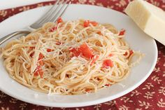 This Garlic Spaghetti is a super easy and budget friendly dinner idea.