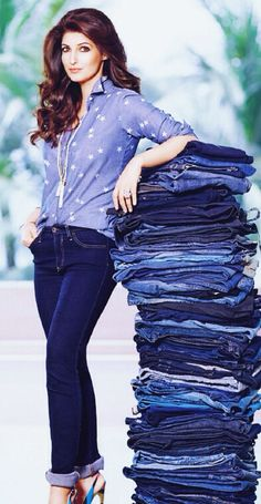 Twinkle Khanna in blue jeans and blue shirt.