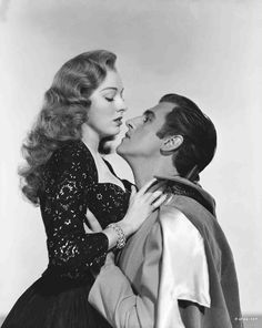 Medium publicity shot of Eleanor Parker as Lenore being embraced by Stewart Granger as Andre Moreau.