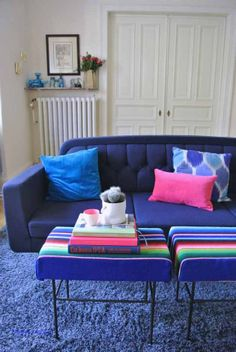 70ies ottoman upholstery with mexican Serape throw Normann Copenhagen Onkel Sofa Blue and pink living room