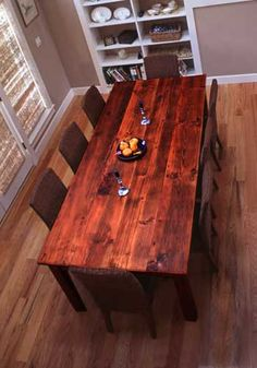 Reclaimed wooden table (I would prefer lighter colored chairs).  Go ahead and call me a tree hugger.  by: Alan Vogel