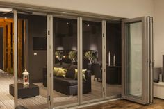 architects love this product - Stainless Steel Security Folding Doors - Sleek stainless steel handles guide the operation. Flush bolts are used to secure large openings along with a 'one flick operation' triple lock.