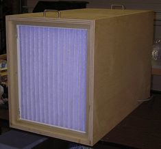 The air filter was made from a set of plans from Woodsmith magazine Vol. The carcass is made from birch plywood and scrap hardwood rails to support the filters. The heart of the filter is an 850 CFM furnace blower that I got for free fr. Woodworking Workshop, Woodworking Projects, Diy Garage, Garage Ideas, Old Tools, Shop Layout, Garage Workshop, Dust Collection, Diy Cleaning Products